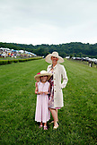 USA, Tennessee, Nashville, Iroquois Steeplechase, a mother and daughter walk on the track between races