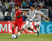 Calcio, Champions League: Gruppo D - Juventus vs Siviglia. Torino, Juventus Stadium, 30 settembre 2015. <br /> Juventus&rsquo; Paulo Dybala, right, is challenged by Sevilla's Benoit Tremoulinas during the Group D Champions League football match between Juventus and Sevilla at Turin's Juventus Stadium, 30 September 2015. <br /> UPDATE IMAGES PRESS/Isabella Bonotto