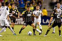 Columbus Crew midfielder Dilly Duka battles LA Galaxy midfielder Dema Kovalenko. The LA Galaxy defeated the Columbus Crew 3-1 at Home Depot Center stadium in Carson, California on Saturday Sept 11, 2010.