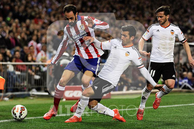 Atletico de Madrid´s Juanfran and Valencia CF´s Jose Gaya and Pablo Piatti during 2014-15 La Liga match between Atletico de Madrid and Valencia CF at Vicente Calderon stadium in Madrid, Spain. March 08, 2015. (ALTERPHOTOS/Luis Fernandez)
