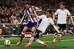 Atletico de Madrid´s Juanfran and Valencia CF´s Jose Gaya and Pablo Piatti during 2014-15 La Liga match between Atletico de Madrid and Valencia CF at Vicente Calderon stadium in Madrid, Spain. March 08, 2015. (ALTERPHOTOS/Luis Fernandez)