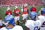 Wisconsin Badgers captains (from left to right) Jay Valai (2), Culmer St.Jean (15) and Gabe Carimi (68) gather at midfield with honorary captain Pat Richter for the coin toss prior to an NCAA college football game against the San Jose State Spartans on September 11, 2010 at Camp Randall Stadium in Madison, Wisconsin. The Badgers beat San Jose State 27-14. (Photo by David Stluka)