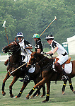 (R) Prince Harry competing at the 3rd Annual Veuve Clicquot Polo Classic on Governors Island on June 27, 2010.