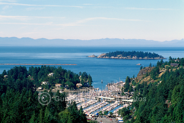 Overlooking Howe Sound and Thunderbird Marina at Fisherman's Cove, West Vancouver, BC, British Columbia, Canada - Vancouver Island in background
