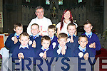 Pupils of Scoil Mhuire N.S. Who made their First holy Communion in Cahersiveren on Saturday were front l-r, James Mahony, Jamie McCrohan, Jack Mahony, Jason O'Connor, Middle l-r, Kian Esmonde, Ruairi O'Shea, John O'Connor, Stevie Coffey, Daniel O'Sullivan, back Cannon Billy Crene & Orla Costello.