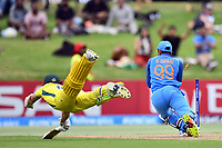 India's wicket keeper Harvik Desai runs out a diving Australia's Baxter Holt  during the ICC U-19 Cricket World Cup 2018 Finals between India v Australia, Bay Oval, Tauranga, Saturday 03rd February 2018. Copyright Photo: Raghavan Venugopal / © www.Photosport.nz 2018 © SWpix.com (t/a Photography Hub Ltd)