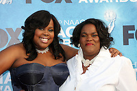 LOS ANGELES -  4: Amber Riley & mother arriving at the 42nd NAACP Image Awards at Shrine Auditorium on March 4, 2011 in Los Angeles, CA