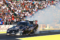 Aug. 3, 2014; Kent, WA, USA; NHRA funny car driver Alexis DeJoria does her burnout in front of the crowded grandstands during the Northwest Nationals at Pacific Raceways. Mandatory Credit: Mark J. Rebilas-