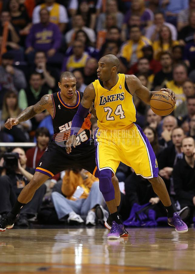 Jan. 30, 2013; Phoenix, AZ, USA: Los Angeles Lakers guard Kobe Bryant (24) against Phoenix Suns guard Shannon Brown at the US Airways Center. Mandatory Credit: Mark J. Rebilas-