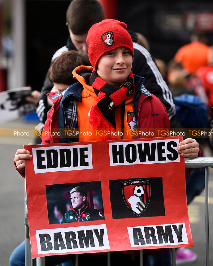 A young AFC Bournemouth fan displays a poster during AFC Bournemouth vs Swansea City, Premier League Football at the Vitality Stadium on 18th March 2017