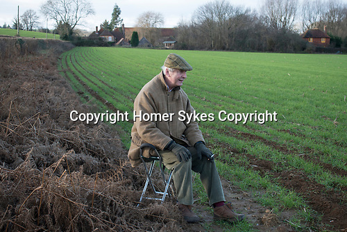 Chiddingfold Leconfield and Cowdray Hunt, New Years Day Midhurst West Sussex 2019. Charles Roberts local business man sitting on shooting stick.