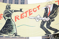 "A banner depicts the Statue of Liberty holding back Donald Trump with a missile as his penis reading ""We the people reject Trump's arms race,"" in Franklin Square in Washington, D.C., on Jan. 19, 2017, the day before the inauguration of president-elect Donald Trump."