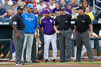 UCLA Bruins head coach John Savage and LSU Tigers head coach Paul Maineri meet with the umpires before Game 4 of the 2013 Men's College World Series on June 16, 2013 at TD Ameritrade Park in Omaha, Nebraska. UCLA defeated LSU 2-1. (Andrew Woolley/Four Seam Images)