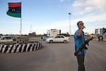 A volunteer directs traffic at the entrance to Misrata, Libya, Oct. 6, 2011. In the wake of its success in repelling the long siege of Misrata by Qaddafi loyalists, the Misrata military council has not been afraid of asserting its authority in Misrata and further.