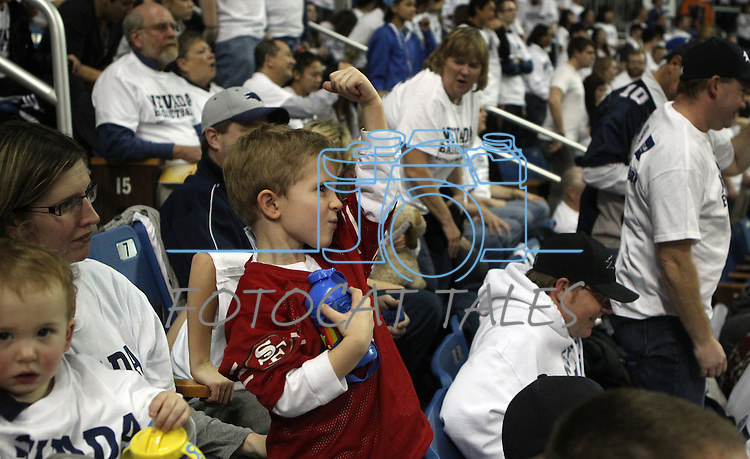 "Zachary Folen, 4, show his support for quarterback Colin Kaepernick by ""Kaepernicking"" during the NCAA men's basketball game between San Diego State and Nevada, on Wednesday, Jan. 23, 2013 in Reno, Nev. Nevada officials held a 15-second event encouraging fans to kiss their biceps in honor of Kaepernick who graduated from Nevada in 2011. (AP Photo/Cathleen Allison)"