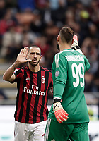 Calcio, Serie A: Milano, stadio Giuseppe Meazza (San Siro), 1 ottobre 2017.<br /> Milan's captain Leonardo Bonucci (l) reacts with Milan'sd goalkeeper Gianluigi Donnarumma (r) during the Italian Serie A football match between Milan and AS Roma at Milan's Giuseppe Meazza (San Siro) stadium, October 1, 2017.<br /> UPDATE IMAGES PRESS/IsabellaBonotto