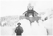 Front view of plow-flanger #02 with Russell Wallace posing in deep snow.<br /> RGS