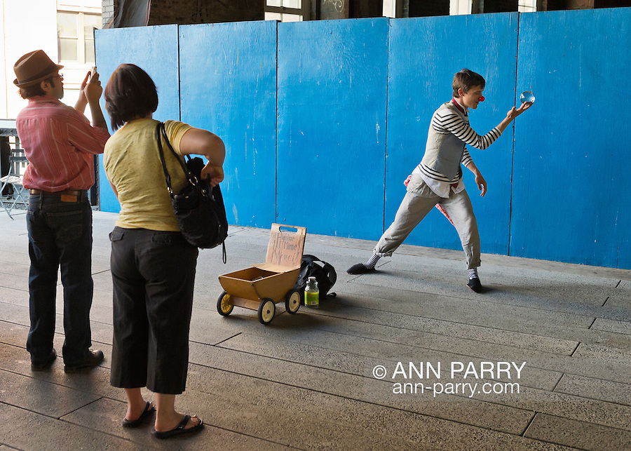 April 27, 2013 - Manhattan, New York, U.S. - The High Line Mime performs at the public park built on an abandoned freight rail line elevated above the streets on Manhattan's West Side, which had many visitors that pleasant warm spring day.