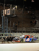 Apr 16, 2009; Avondale, AZ, USA; NASCAR Camping World Series West driver Jason Bowles takes the checkered flag to win the Jimmie Johnson Foundation 150 at Phoenix International Raceway. Mandatory Credit: Mark J. Rebilas-