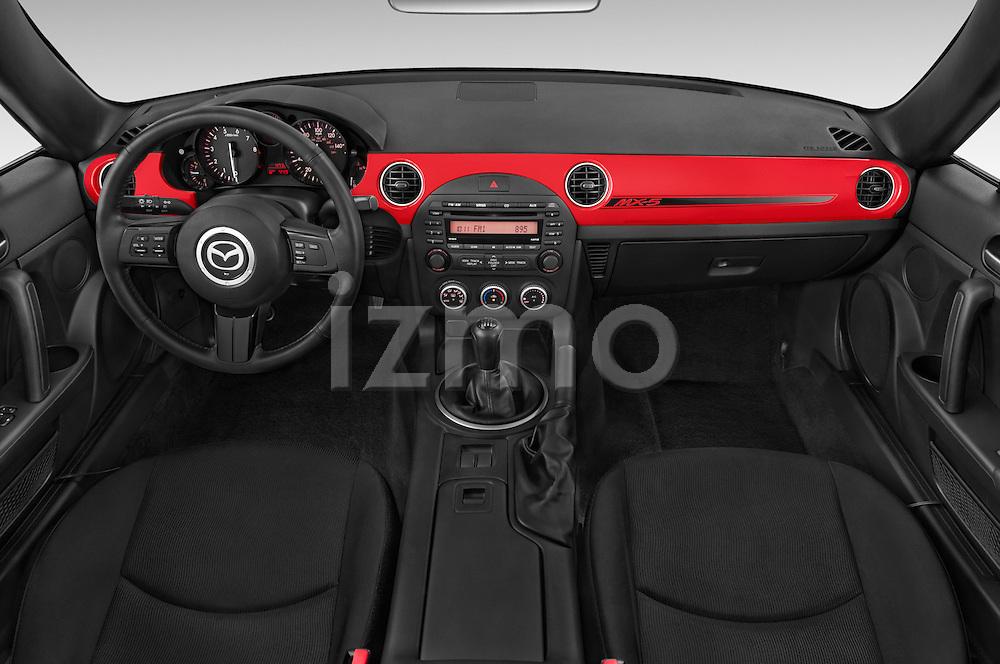 Stock photo of straight dashboard view of a 2015 Mazda MX-5 Miata Club Auto 2 Door Convertible Dashboard