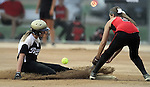 SIOUX FALLS, SD - JULY 7:  McKenzie Papp #8 from the Minnesota Renegades slides safely into second as the ball gets away from Gretta Schlief #9 of the Shakopee Stealth in the first inning of their 2013 Ringneck Softball tournament U16 Championship game Sunday evening at Sherman Park. (Photo by Dave Eggen/Inertia)