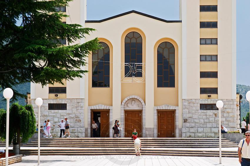 The facade of The church with its twin church towers. Medugorje pilgrimage village, near Mostar. Medjugorje. Federation Bosne i Hercegovine. Bosnia Herzegovina, Europe.