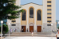 The facade of The church with its twin church towers. Medugorje pilgrimage village, near Mostar. Medjugorje. Federation Bosne i Hercegovine. Bosnia Herzegovina, Europe.