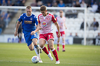 Charlie Carter of Stevenage lays the ball off under pressure from Luke Norris of Colchester United during Colchester United vs Stevenage, Sky Bet EFL League 2 Football at the JobServe Community Stadium on 5th October 2019