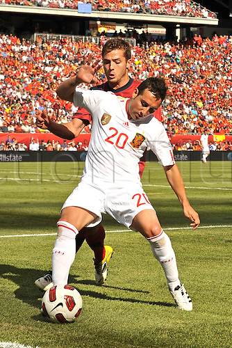 04.06.2011. Spain midfielder Santiago Cazorla (20) tries to get control of the ball before it goes out of bounds during the Spain game against the USA at Gillette Stadium in Foxborough, MA