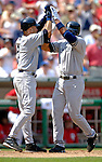 17 June 2006: Alex Rodriguez (right), third baseman for the New York Yankees, celebrates a two-run homer with teammate Derek Jeter (left) action against the Washington Nationals at RFK Stadium, in Washington, DC. The Nationals overcame a seven run deficit to win 11-9 in the second game of the interleague series...Mandatory Photo Credit: Ed Wolfstein Photo...