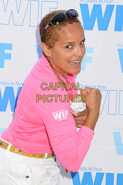 Shari Belafonte<br /> 16th Annual Women In Film Malibu Golf Classic held at the Malibu Golf Club, Malibu, California, USA, 13th July 2013.<br /> half length pink top arm side gesture <br /> CAP/ADM/BP<br /> &copy;Byron Purvis/AdMedia/Capital Pictures