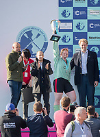 Mortlake/Chiswick, GREATER LONDON. United Kingdom. Women's Boat Race, CUWBC President, Ashton BROWN, rises the trophy in triump, when presented by Andrew TRIGGS HODGE,  the Championship Course, <br />  Putney to Mortlake on the River Thames. <br /> <br /> Sunday  02/04/2017<br /> <br /> [Mandatory Credit; Peter SPURRIER/Intersport Images]
