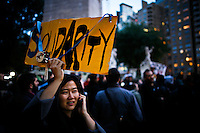A woman takes part in a protest called global noise at Manhattan in New York, United States. 13/10/2012. Photo by Eduardo Munoz Alvarez / VIEWpress.