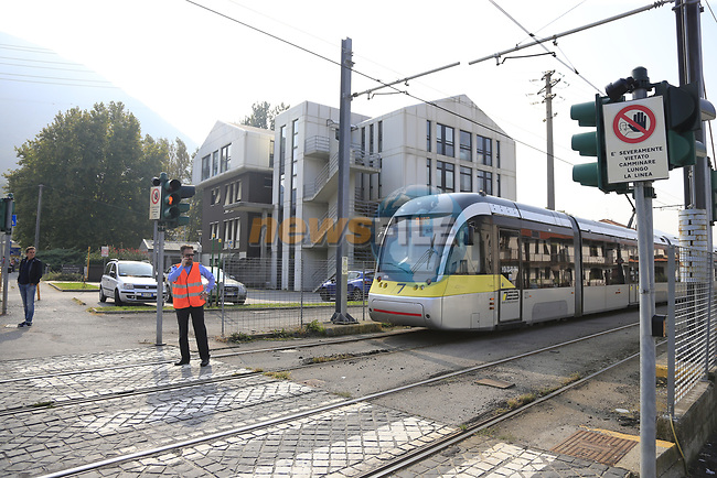 Trains are stopped for the race to pass by a level crossing at Albino during the 112th edition of Il Lombardia 2018, the final monument of the season running 241km from Bergamo to Como, Lombardy, Italy. 13th October 2018.<br /> Picture: Eoin Clarke | Cyclefile<br /> <br /> <br /> All photos usage must carry mandatory copyright credit (© Cyclefile | Eoin Clarke)