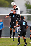 Torrance, CA 02/23/11 - Salesian's Ludwing Vargas (Salesian #5) jumps up but Justin Kim (Bishop Montgomery #5) leaps higher and jumps over him to head the ball at midfield.