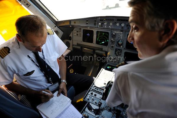 copyright : magali corouge / Documentography.10/06/09.Me?tier : Pilote..Laurent Guerini et son co pilote Thibaud dans le cockpit avant le decollage.