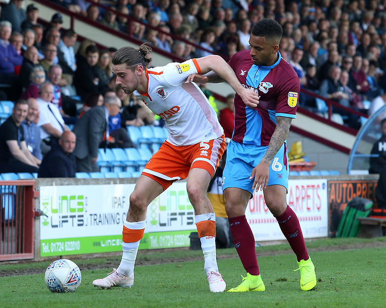 Blackpool's Antony Evans holds off the challenge from Scunthorpe United's Funso Ojo<br /> <br /> Photographer David Shipman/CameraSport<br /> <br /> The EFL Sky Bet League One - Scunthorpe United v Blackpool - Friday 19th April 2019 - Glanford Park - Scunthorpe<br /> <br /> World Copyright © 2019 CameraSport. All rights reserved. 43 Linden Ave. Countesthorpe. Leicester. England. LE8 5PG - Tel: +44 (0) 116 277 4147 - admin@camerasport.com - www.camerasport.com
