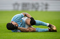 Gabriel Jesus of Manchester City holds his knee in pain after doing down injured during the Premier League match between Crystal Palace and Manchester City at Selhurst Park, London, England on 31 December 2017. Photo by Andy Rowland.
