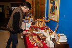 BETHLEHEM, CT. 21 December 2019-122119BS303 - Roman Achille of Shelton looks over the many items for sale, during the annual holiday pop-up sale in the Jubilee Barn at the Abbey of Regina Laudis in Bethlehem on Saturday. Bill Shettle Republican-American