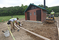 NWA Democrat-Gazette/FLIP PUTTHOFF <br />TRAILSIDE REST STOP<br />Xendy Tatibouet (cq) (from left), Brett Blockhus and Joe Thomas work on a restroom building along the Razorback Greenway in Bentonville. The restroom is one-quarter mile east of the Slaughter Pen Mountain Bike Trail entrance in north Bentonville. The crew was building forms and preparing the ground for concrete pouring scheduled forThursday.