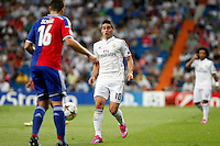 James of Real Madrid and Fabian Schar (FC Basel) during the Champions League group B soccer match between Real Madrid and FC Basel 1893 at Santiago Bernabeu Stadium in Madrid, Spain. September 16, 2014. (ALTERPHOTOS/Caro Marin) /NortePhoto.com