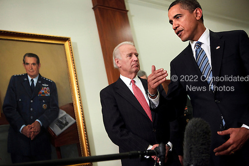 Arlington, VA - January 28, 2009 -- United States Vice President Joe Biden (L) listens to President Barack Obama (R) speak to the press after a meeting at the Pentagon, Wednesday, January 28, 2009 in Virginia.  President Barack Obama and Vice President Joe Biden met with Secretary of Defense Robert Gates and the Joint Chiefs of Staff to discuss America's military situation in the world..Credit: Brendan Smialowski - Pool via CNP