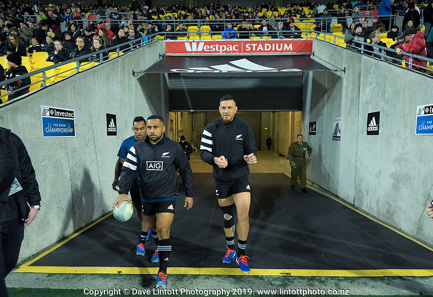 From left, Sevu Reece, Ngani Laumape and Sonny Bill Williams walk onto the pitch during the Rugby Championship rugby union match between the New Zealand All Blacks and South Africa Springboks at Westpac Stadium in Wellington, New Zealand on Saturday, 27 July 2019. Photo: Dave Lintott / lintottphoto.co.nz
