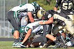 Palos Verdes, CA 10/08/10 - Haden Gregory (Peninsula #42), Eric Capacchione (South #43) and Orion Gould (South #71) in action during the South Torrance Spartans vs Peninsula Panthers Varsity football game at Palos Verdes Peninsula High School.