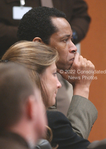 Sniper suspect John Allen Muhammad, listens to closing arguments during his trial along with attorney Christie Leary at the Virginia Beach Circuit Court in Virginia Beach, Virginia on November 13, 2003.<br /> Credit: Steve Earley - Pool via CNP