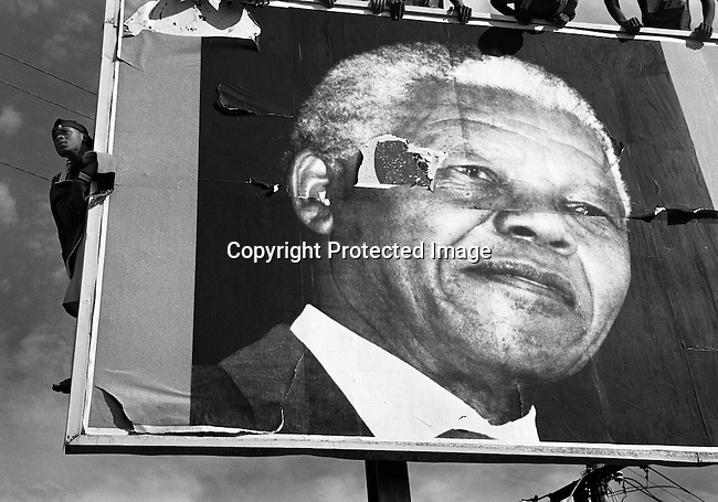 ANC supporters wait for President Nelson Mandela's motorcade to pass by during an election campaign on April 13, 1994 in Durban, South Africa. Nelson Mandela and the African National Congress campaigned in the area a few weeks before the first historic democratic election on April 27, 1994. President Nelson Mandela served one 5-year term and retired in 1999. (Photo by Per-Anders Pettersson)