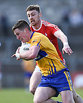 Eoin Cleary of Clare in action against James Craven of Louth during their national League game in Cusack Park. Photograph by John Kelly.