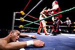 Lucha Libre AAA wrestler Rocky Romero recovers ringside in Sacramento, CA March 28, 2009.