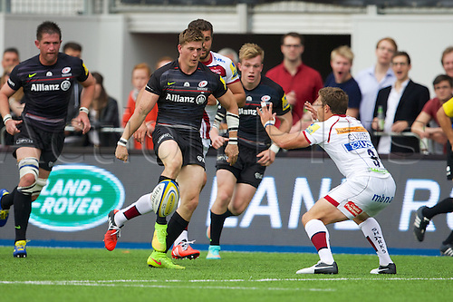 27.09.2014. Hendon, England.  Aviva Premiership. Saracens versus Sale Sharks. Saracens wing David Strettle and Sale Sharks scrum-half Chris Cusiter.