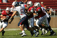 14 October 2006: Chris Marinelli and Ismail Simpson block for Toby Gerhart during Stanford's 20-7 loss to Arizona during Homecoming at Stanford Stadium in Stanford, CA.